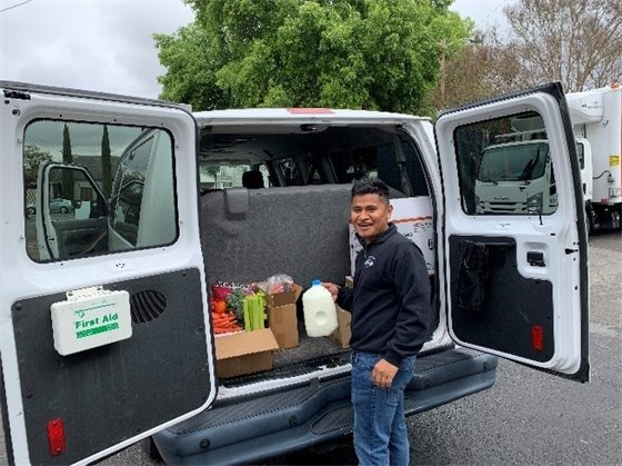 Image of Community Services staff member delivering groceries to seniors.