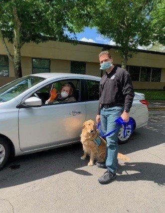 Leo the therapy dog and Lt. Matt Jenkins