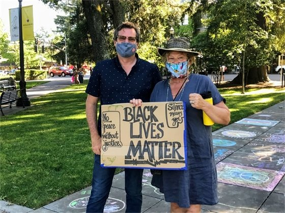 David Hagele and Brigette Manselle with sign at vigil for George Floyd, June 5, 2020