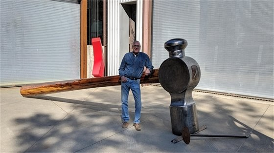 Artist with his hammer installation