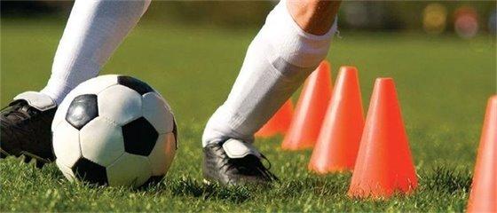 Image of soccer player kicking soccer ball