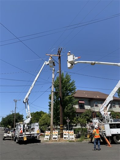 Workers replacing utility pole