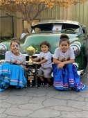 Kids in front of an old car