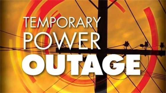 Image of power lines and the text Temporary Power Outage