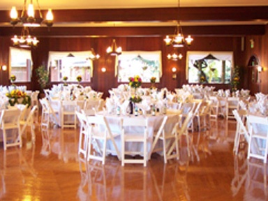 Tables and chairs arranged for an event in a ballroom